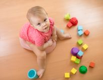 Child sits on chamber pot, toilet, playing with toys. Top view. Royalty Free Stock Images