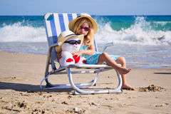 A child sits on a deck chair with a toy Royalty Free Stock Photo