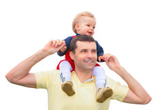 Child sits at father on shoulders. Little child sits at father on shoulders stock photography
