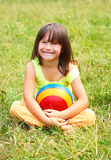 The child sits on a grass Stock Photo