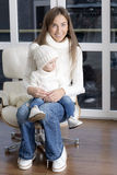 Child sits on the lap of mother. Stock Photo