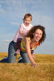 Child sits on the mom Stock Image