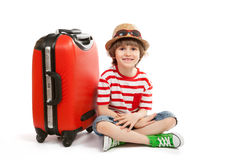 Child sits at a red trunk Royalty Free Stock Image