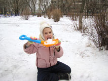 Child sits in the snow Stock Photos