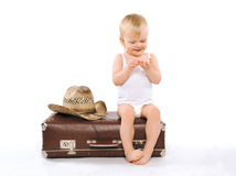 Child sits suitcase counts money on tours, travel, vacation. Concept Stock Image