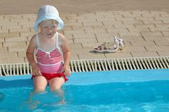 Child sits at swimming pool Royalty Free Stock Images