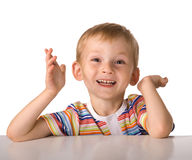 The child sits at a table Royalty Free Stock Image