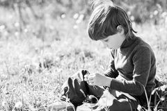 Child sits and thinks Royalty Free Stock Photo