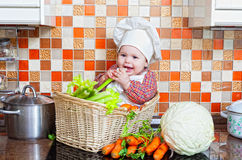 Child sits in a wattled basket Royalty Free Stock Images