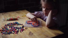 Little cute girl playing with colorful mosaic. stock footage