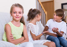 Child sitting aside of boy and girl Royalty Free Stock Photo