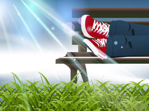 Child sitting on a bench Stock Image