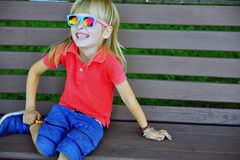 Child sitting on the bench Stock Photos
