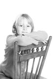 Child sitting in chair Royalty Free Stock Images