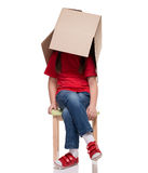 Child sitting on a chair with big box covered head. Isolated on white Stock Photos