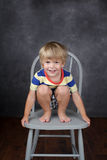 Child sitting on chair in School, Education Royalty Free Stock Photos