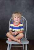 Child sitting on chair in School, Education Stock Images