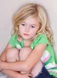 Child sitting in corner Stock Photos