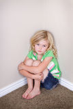 Child sitting in corner Royalty Free Stock Photo