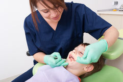 Child sitting on dentist chair Royalty Free Stock Images