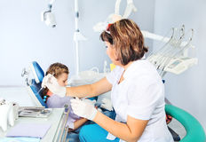 Child in a dentist's chair Stock Images