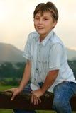 Child sitting on fence Royalty Free Stock Photo