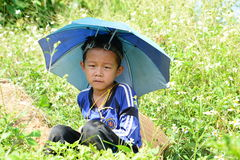 Child sitting in a field. Hmong tribe village. Ban Hin Ngon. Vientiane province. Laos. The Hmong is an ethnic group from the mountainous regions of China Royalty Free Stock Photos
