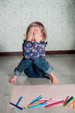 Child sitting on the floor Stock Photography