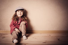 Child sitting on the floor Royalty Free Stock Photography