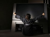 Child Sitting In Front Of Television Stock Photography