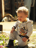 Child sitting on a garden path Royalty Free Stock Image