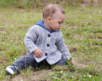 Child sitting on grass Royalty Free Stock Photo