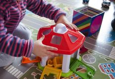 Child playing with plastic toys Stock Images