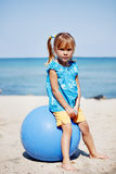 Child sitting on gymnastic ball Royalty Free Stock Photos