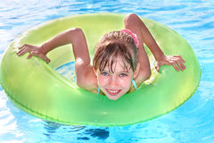 Child sitting on inflatable ring. Stock Photos