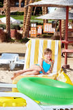 Child sitting on inflatable ring. Stock Images
