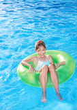 Child sitting on inflatable ring . Royalty Free Stock Image