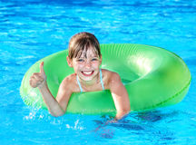 Child sitting on inflatable ring thumb up. Stock Photography
