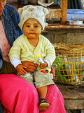 Child sitting on mother`s lap at Ayeyarwady river port in Mandal Stock Photography