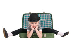 Child sitting in an old green suitcase Stock Images