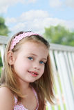 Child Sitting Outdoors Royalty Free Stock Photo