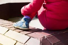 Child sitting outdoors Stock Photos