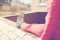 Child sitting outdoors Stock Images