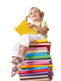 Child sitting on pile of books. Royalty Free Stock Photos