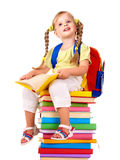 Child sitting on pile of books. Stock Images