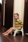 Child sitting on potty Stock Photos