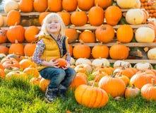 Child sitting on pumpkin Royalty Free Stock Photos