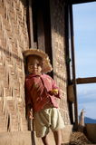 Child sitting on the step  in the village. In the afternoon sun Stock Images