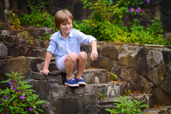 Child sitting on steps Royalty Free Stock Image