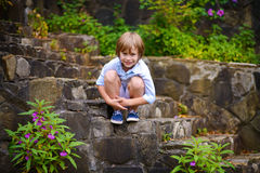 Child sitting on steps Royalty Free Stock Images